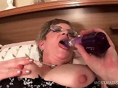 Mature in glasses fucks herself with big dildo