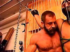 Restrained hot beefy dudes balls bashed by a bear