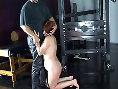 Hot redhead is restrained with red ropes and has her old llaids china spanked hard
