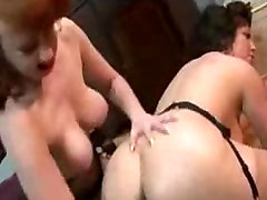 Redhead and brunette mature licking and fisting