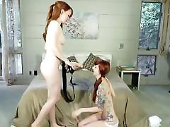 Redhead Lesbians Fuck With Strapon