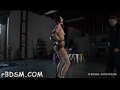 Chained up hottie is punished