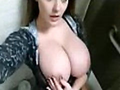 Hot busty finger fucking in public toilet nearly gets caught!