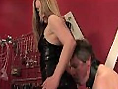 BDSM mistress whipping her bound sub