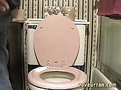 Teen girl caught peeing in toilet on hidden voyeur cam.
