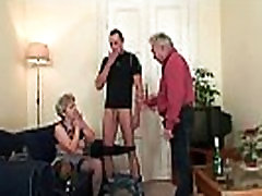 Horny old granny takes two cocks at once