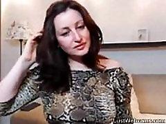 Russian brunette rides dildo on webcam