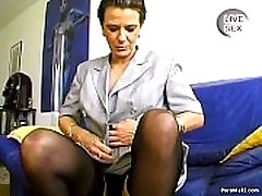 Granny with piercing sucks cock