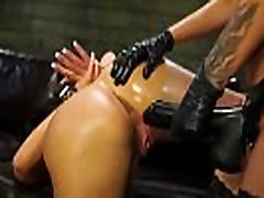 Slave bounces on strapon