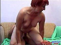 Redhead Granny seduces cute college guy