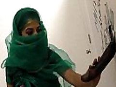 Nadia Ali having fun with black cock in a gloryhole