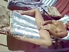 Spying my mum masturbating in court yard. Hidden cam
