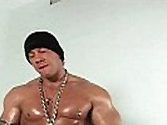 Muscled gay hunk Rob Diesel jerking gay porno