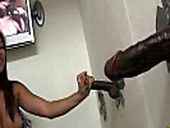 Ebony sucks off a big cock through a gloryhole 17