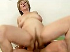 Grey granny buffing young cock