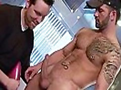 Tattooed and pierced hunk stripping gay porn