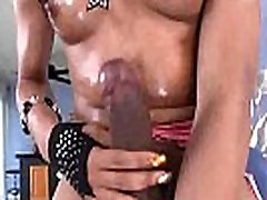 Ebony shemale in fishnet stockings jerks her big cock off