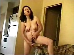 Mature woodman pissing fat tits masturbates standing for internet viewers