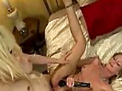 Blonde in red thongs sucks to busty shemale and gets fucked in bed