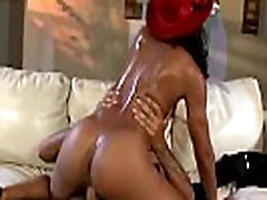 Ebony slut with red hat fucks very hard with her stud on the couch