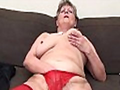 Mature woman in sexy red stockings