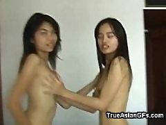 Amateur Asian Lesbians Dildoing