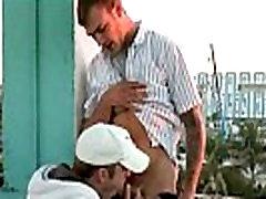Gay couple making love at a balcony