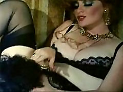 Classic red head indian smingers star Lisa Deleeuw and Ron Jeremy in retro vintage scene