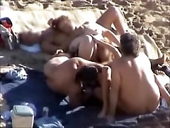Swingers playing at the beach