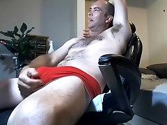 Alluring big cockshutt gangbang is having fun within doors and filming himself on web camera