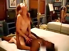 Cuckold pussy obliteration gets creampied by a black stud, while the husband jacks off in a chair