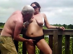 Crazy amateur girl showing couple has sex on a bridge in nature