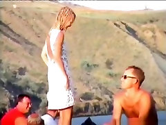 Voyeur tapes a girl getting bodypainted at a nude beach