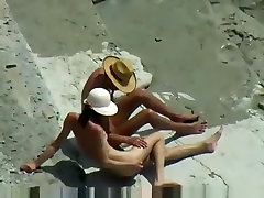 Voyeur tapes a first time tiny sex girl having a doggystyle quickie on a nude beach