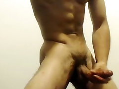 Lovely male is having fun in his room and memorializing himself on webcam