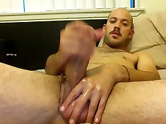 Nice-looking male is relaxing in the guest room and filming himself on web cam