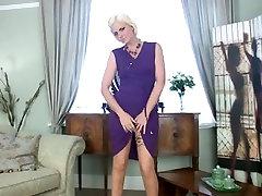Blond MILF Rebecca masturbates in stockings