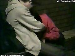 2 couples making teid up sec outside