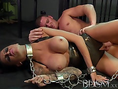 Sexy tattooed Slave girl gets mouth full of cock from Master whist in Shackles