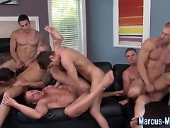 Muscly hunk cummed on in orgy