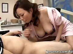 Asian nurse with big tits hides behind a mask