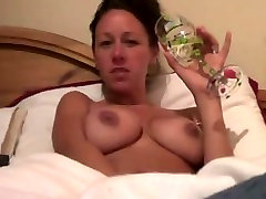 Big-titted slut rubbing her sweet snatch