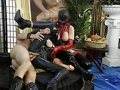 Latex bitches suck huge dildo at fetish rubber party