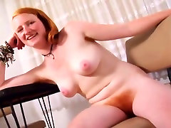 Redhead Cutie Shows Off Her Body While Conversing