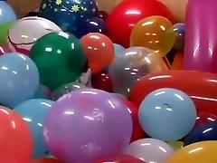 Single woman around balloons