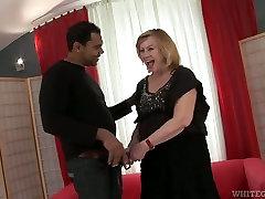 Mature blonde slut sucking big black cock balls deep