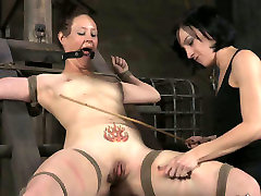 Mistress punishes restrained sex-slave with the help of stick