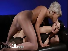 Horny darkhair sucking penis of rubber