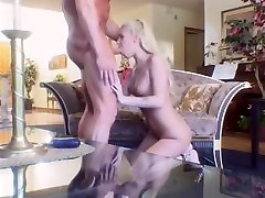 Ripped lad copulates and facializes slender golden-haired wench in the living room