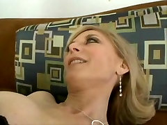 Mature blonde whore sucks and fucks young cock on couch
